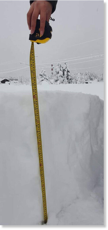 A member of Ulkatcho First Nation measures the snow on Friday, Nov. 27, 2020 showing that more than 60 cms of snow has fallen since a snowfall warning went into effect for northern portions of the Chilcotin on Thursday