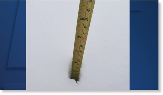 Image of measuring tape in snow in Cuyahoga County from winter storm on Dec. 1, 2020.