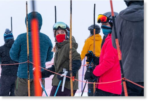 Skiers wear masks while waiting in a lift line at Alyeska Resort on opening day, Friday, Dec. 18, 2020 in Girdwood.