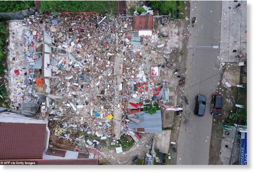 An aerial picture shows flattened homes in Mamuju, West Sulawesi