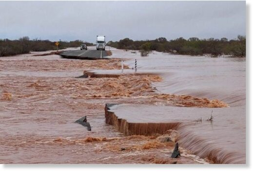 Motorists and truckies are trapped on islands between floodwaters.