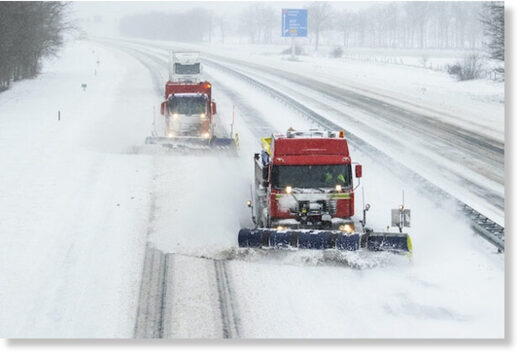 Snow ploughs in action on the A1 motorway on