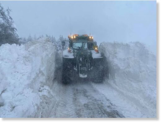 Farmers plough over six foot of snow in Aberdeen
