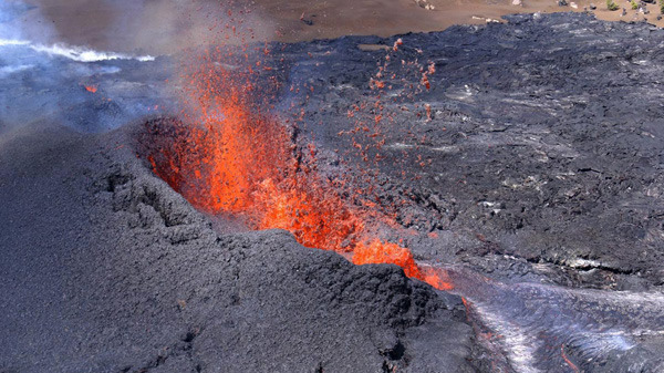 Lava from erupting Hawaii volcano sparks wildfire
