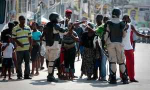 Haitians plead with riot police
