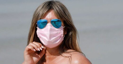 Spain passes law mandating face masks even while swimming in the sea