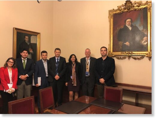 Toka executives are pictured with Chilean officials