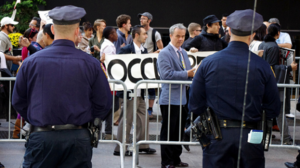NYPD officers observe Occupy Wall protesters