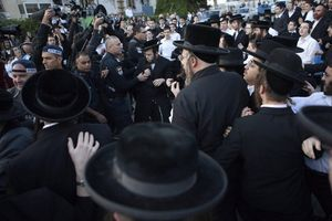 Israelis policemen disperse ultra Orthodox Jewish protesters