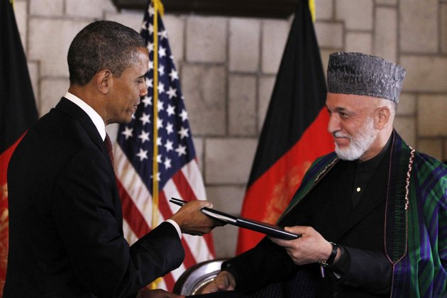 Warmonger: Obama says Afghanistan Deal is one Where 'War Ends and a New Chapter Begins'