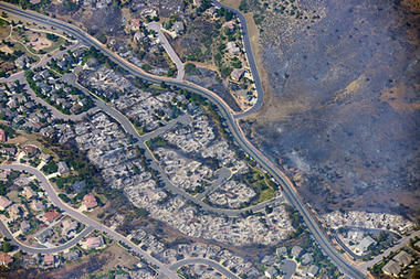 This aerial photo taken on Wednesday, June 27, 2012, shows burned homes in the Mountain Shadows residential area