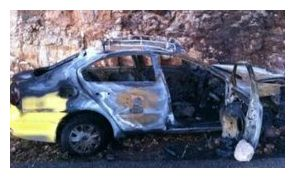 Palestinian taxi burned