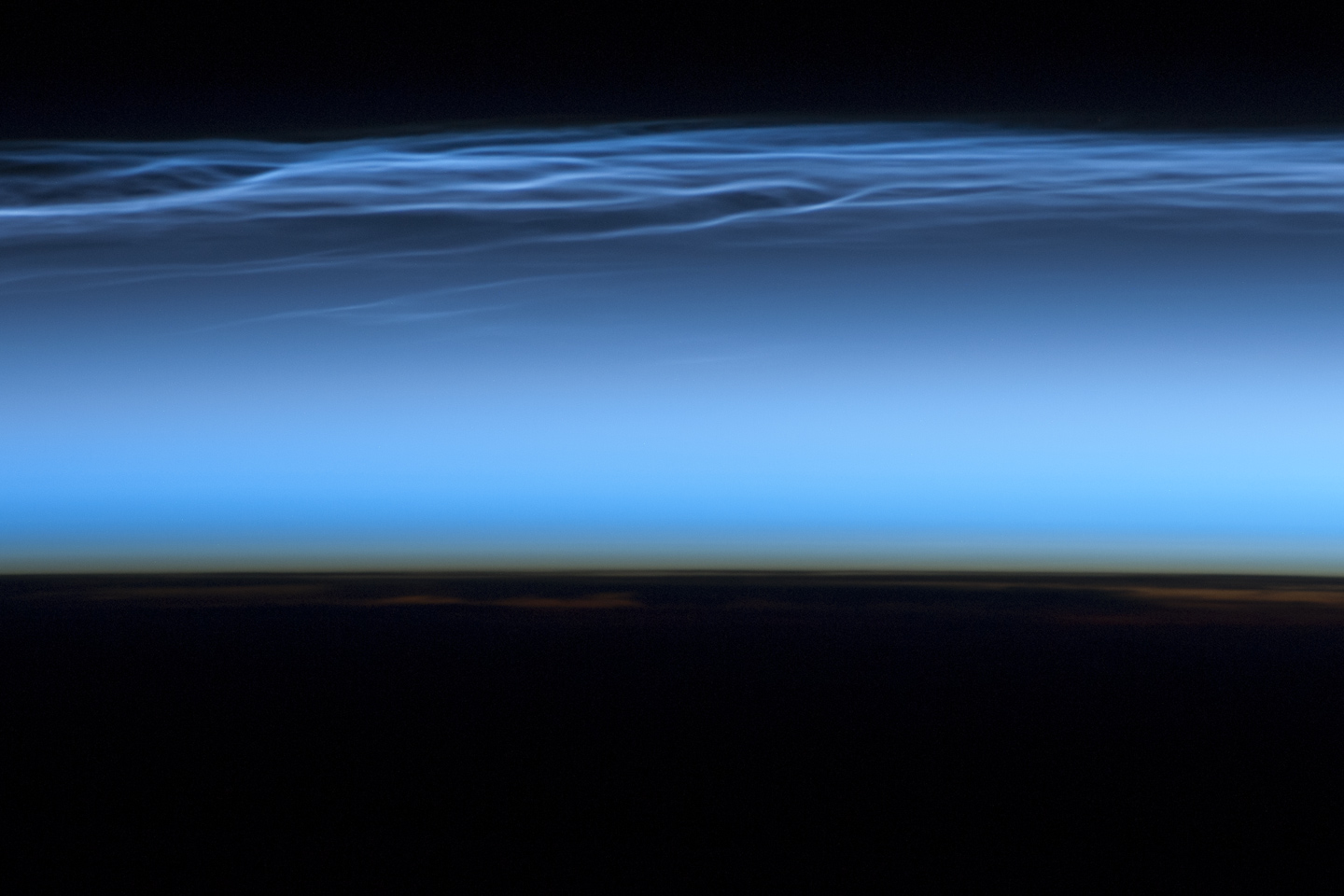 Increased meteor smoke: Noctilucent clouds brightening and spreading south