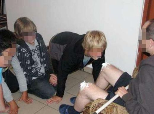 young teens licking cream off a priest's knees