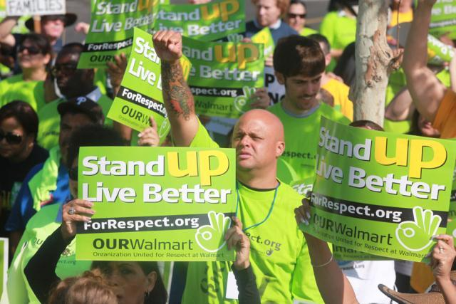 Dozens of LA workers walk off the job in first-ever strike against monster retailer Walmart