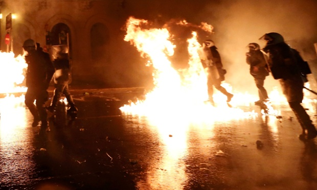 Protests explode in Athens as Greek austerity measures passed
