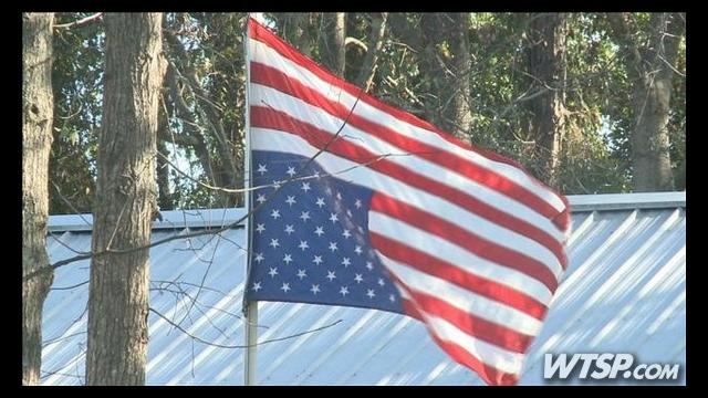 Florida man's upside down flag protest upsets neighborhood on Veterans Day