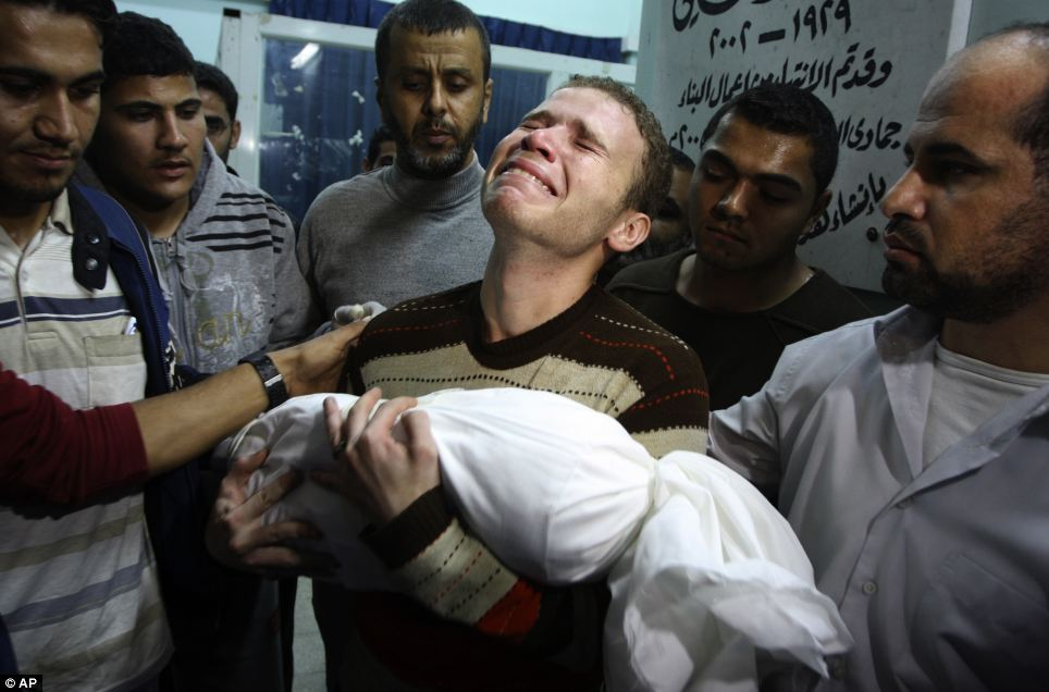 BBC journalist cradles his dead baby son in his arms after Israeli rocket attack on Gaza