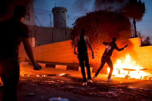 Palestinian youth throw stones