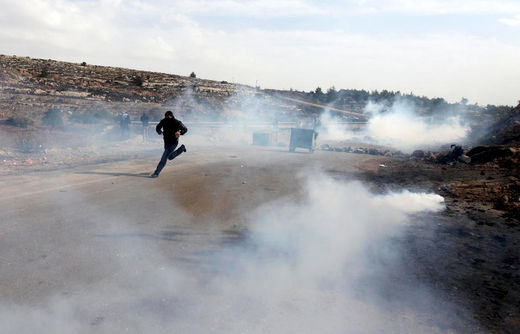 Palestinian protester run