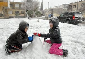 Children play in the snow in the Montenegrin