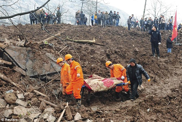 At least 32 dead and 'dozens' more trapped as landslide sweeps away entire village in southern China