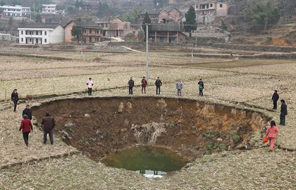 Chinese village suffers over 20 sinkholes in five months