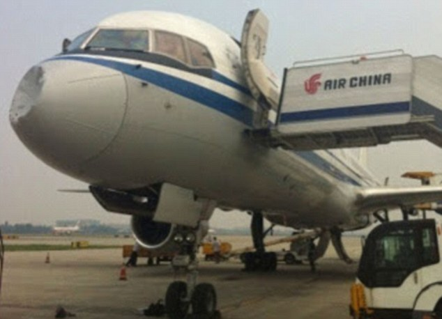Was it a bird? A plane? Or a UFO?? Chinese passenger jet hits mysterious object at 26,000ft and lands with severely dented nose cone