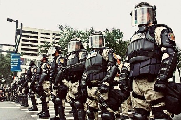 American police state murderous militarized police use swat teams to