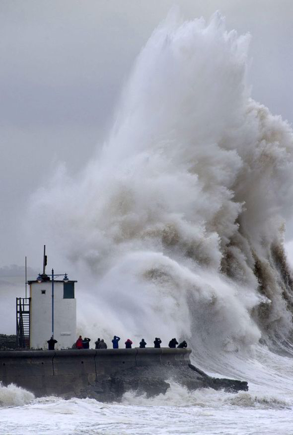 Huge waves smash into British coastline, swells up to 75 feet recorded off-shore, UK government considers establishing tsunami-warning system